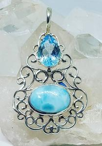Beautiful sublime Larimar, the unique gemstone from the Dominican Republic paired with a sparkling Blue Topaz in .925 Sterling Silver.
